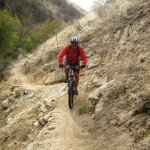 Riding a technical section in Dry Creek